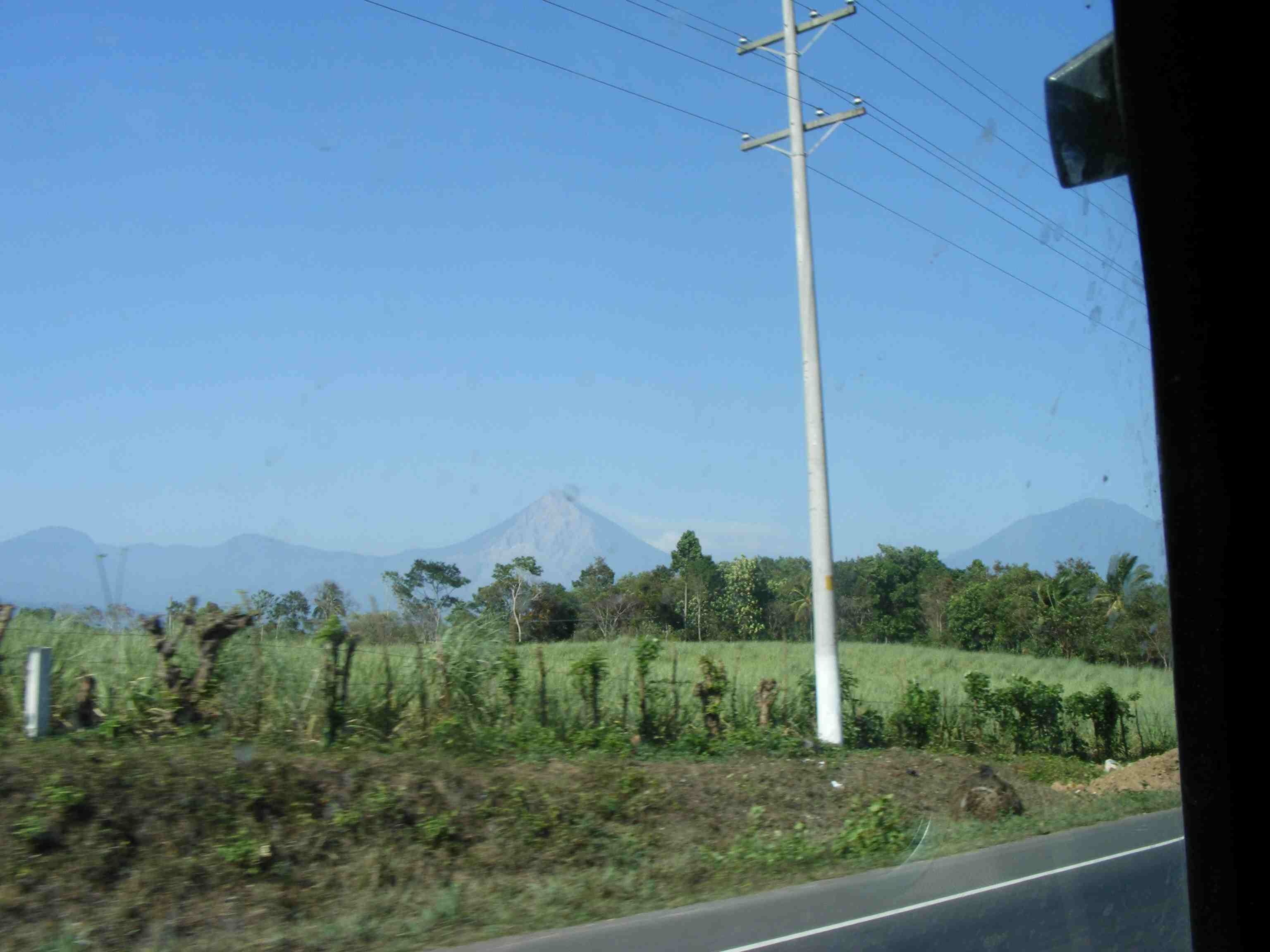 Endless sugarcane fields with Mountains on horizon